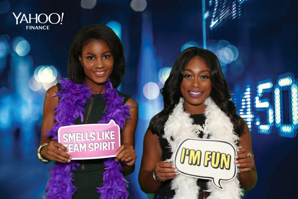Two Women holding up signs for Photo Booths for Corporate Events