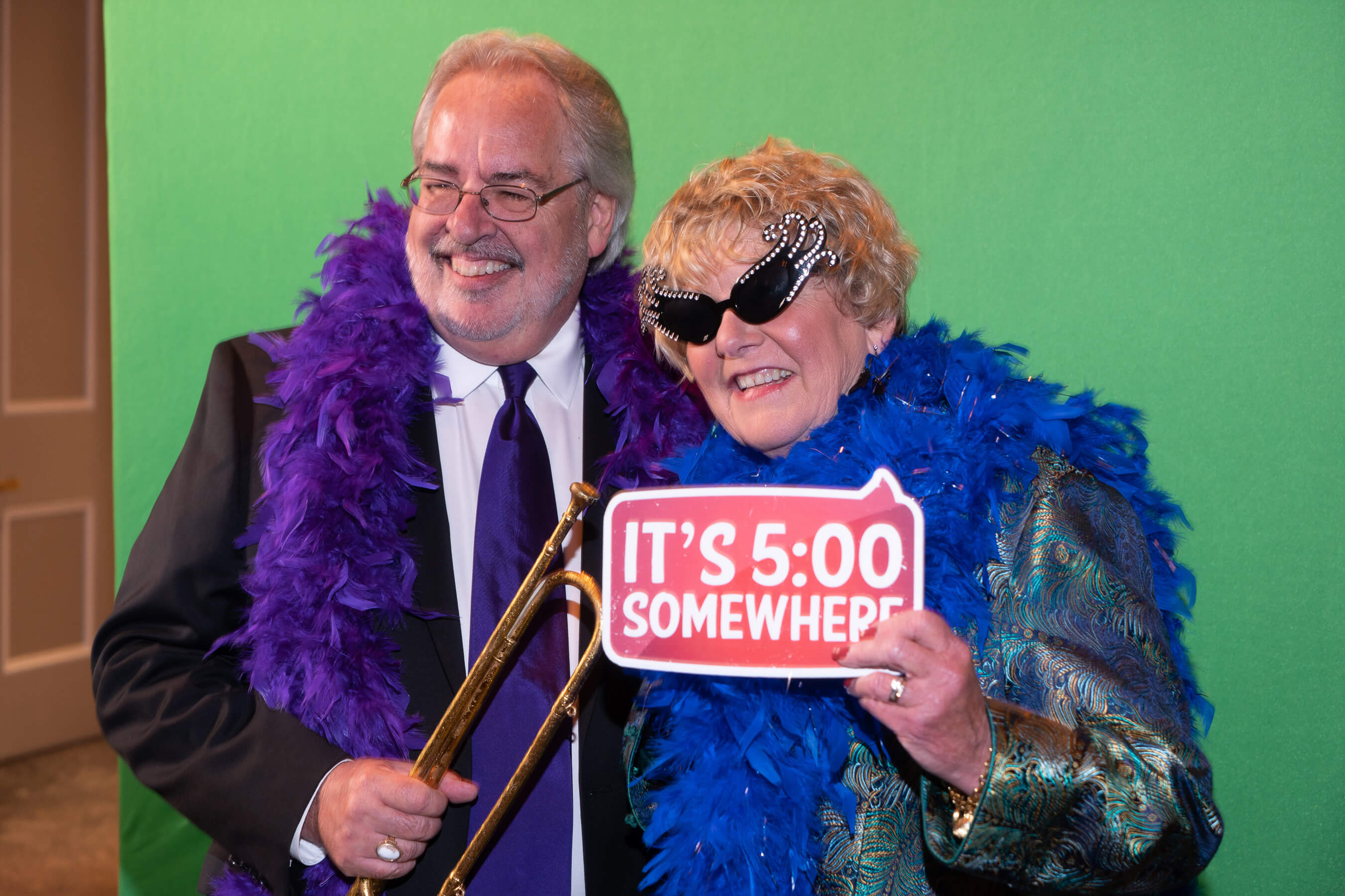 Elderly couple enjoying a photo booth for their corporate event
