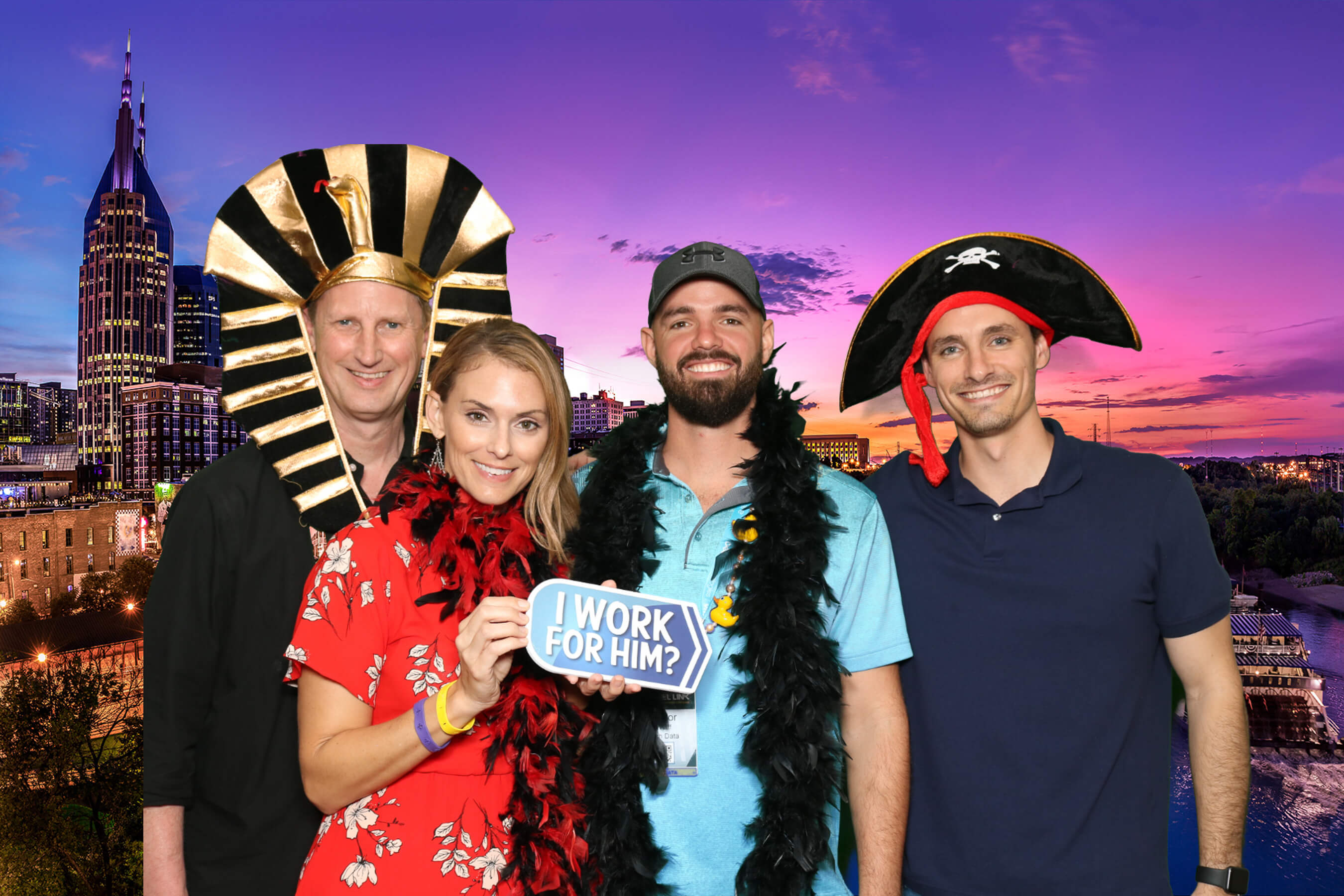 Coworkers celebrating their corporate event with a photo booth