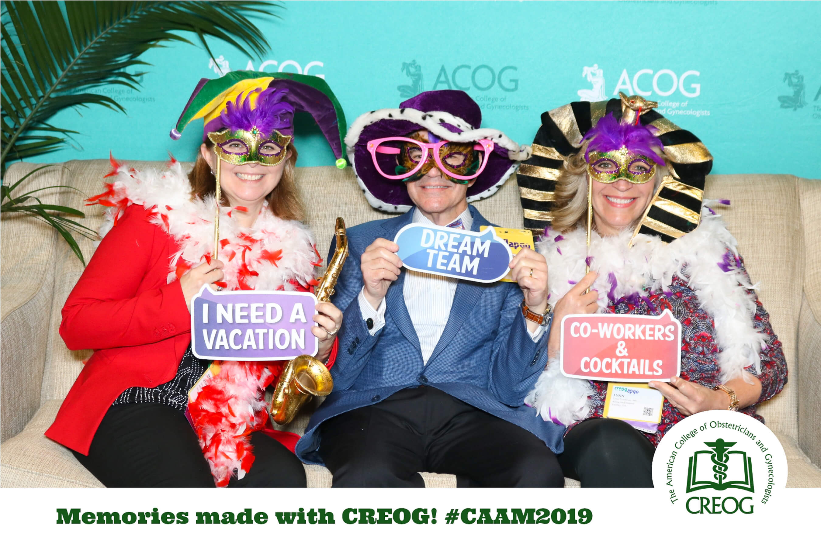 Party guests taking a photo booth picture in silly costumes