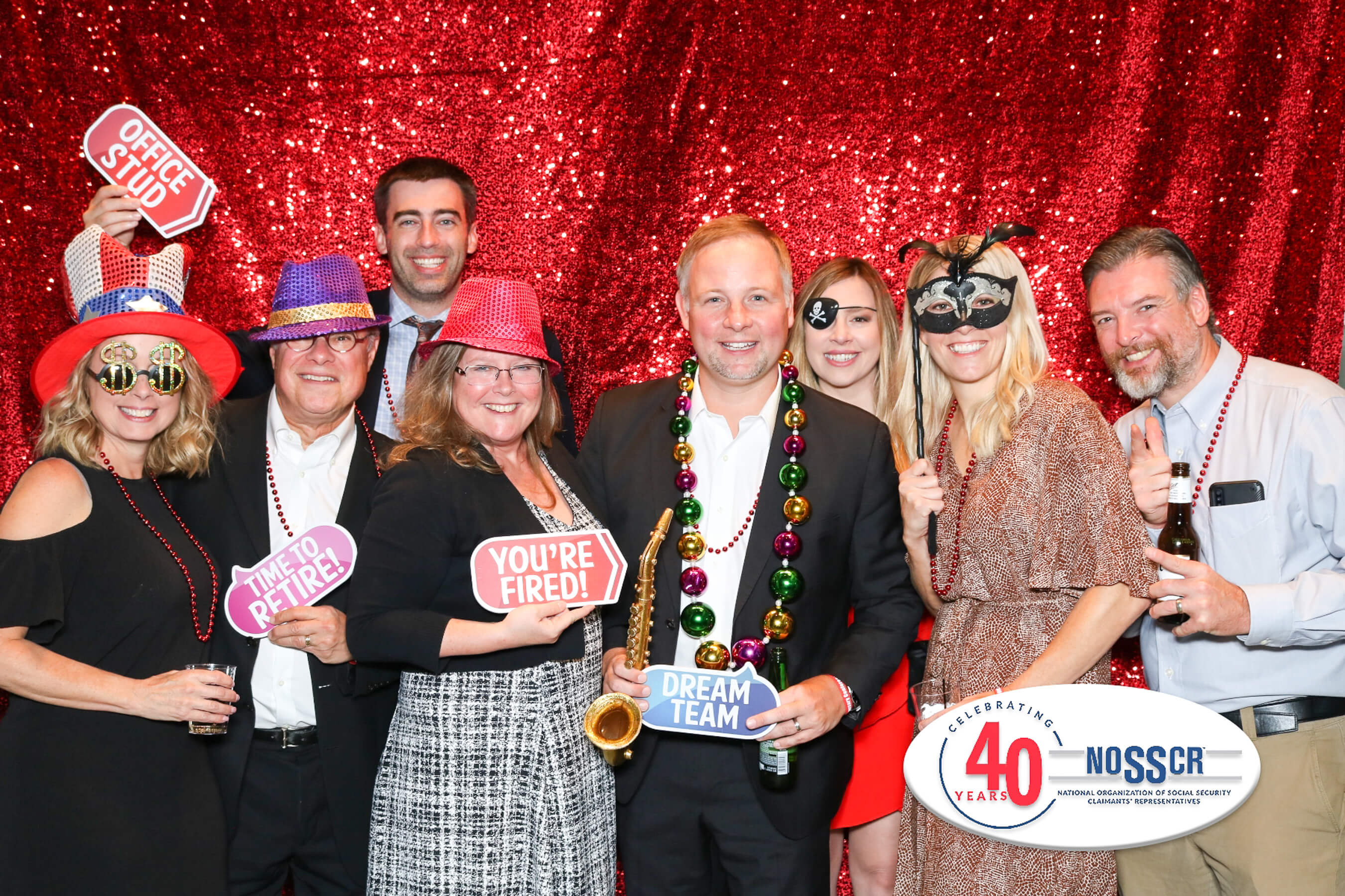 Group of people celebrating with event photo booth rental