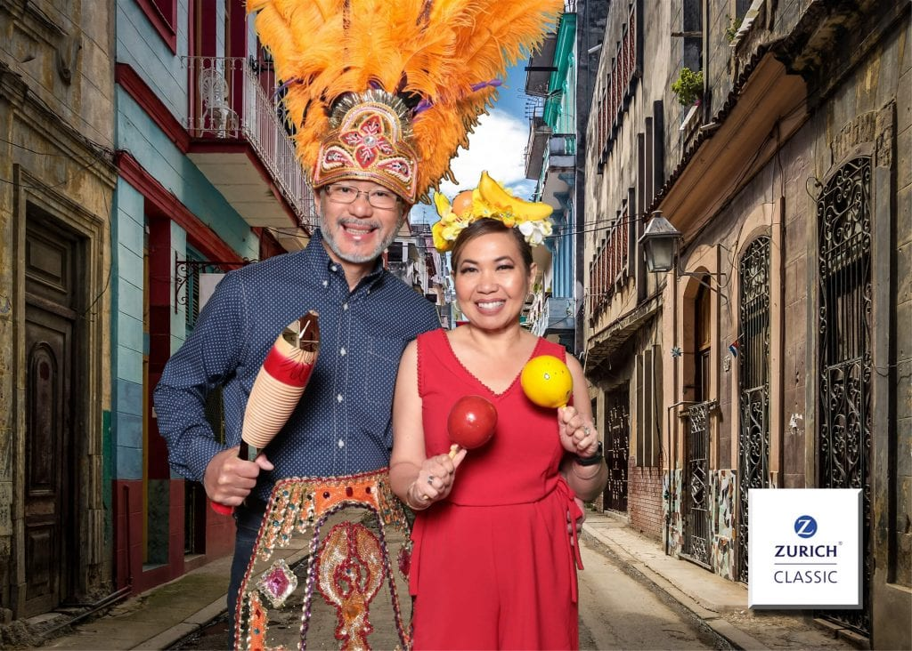 Man and Woman holding maracas in front of a green screen