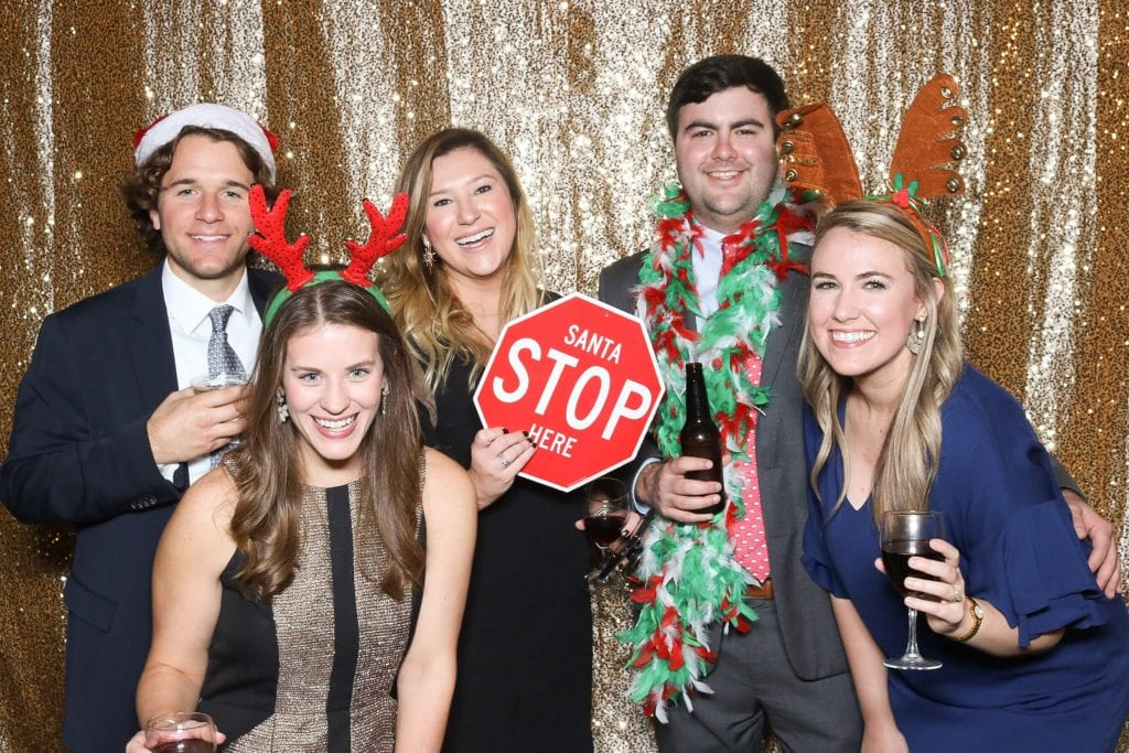 Young group posing for a holiday event photo booth rental