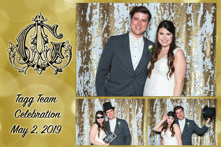 Couple celebrating a wedding with wedding photo booth rental services