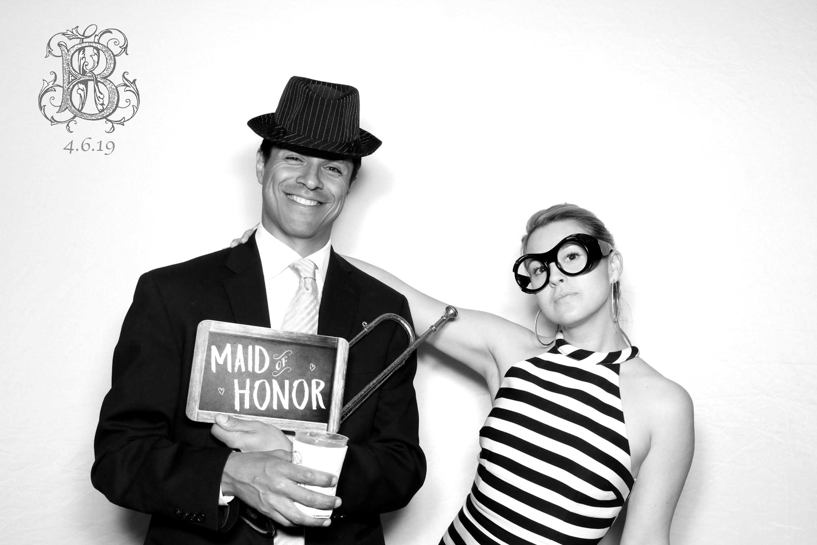 Couple celebrating with 60's inspired costumes for a photo booth